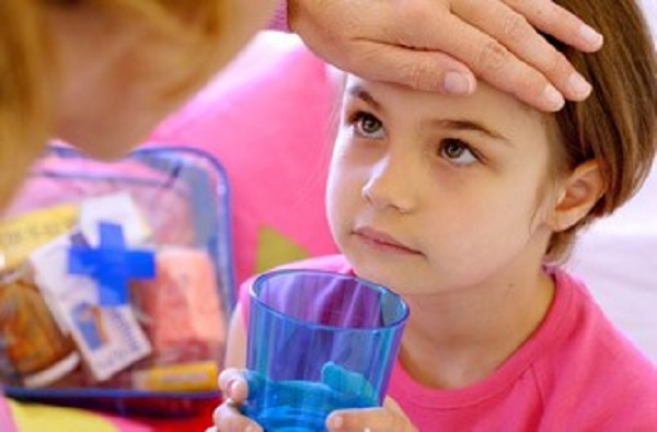 girl-taking-medicine-how-to-treat-the-flu-in-children